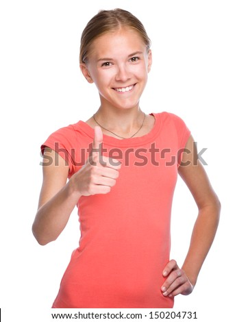 Young girl dressed in red is showing thumb up gesture, isolated over white - stock photo