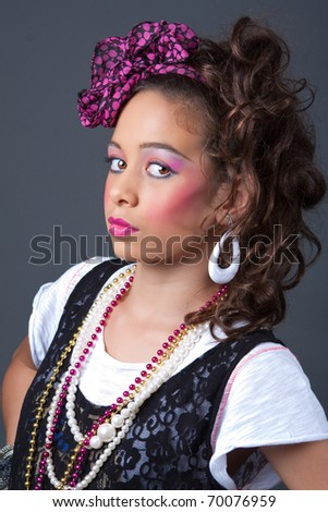 Young girl dressed in 80s style - stock photo