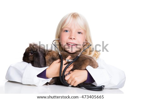 young girl dressed like a vet with a bunny