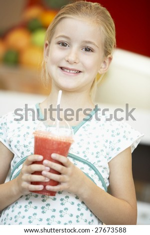 Young Girl Drinking A Berry Smoothie - stock photo