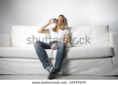 young girl drinking beer at home - stock photo