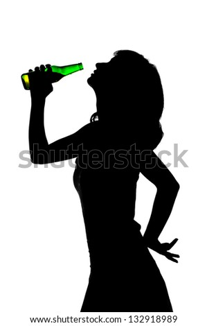 young girl drinking beer from a glass bottle, silhouette - stock photo