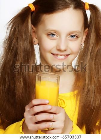 Young Girl Drinking Orange Juice - stock photo