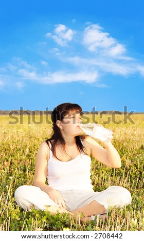 Young girl drinking water - stock photo