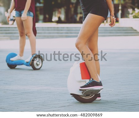 Young girl driving on segway in the park.