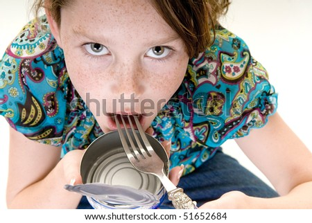 young girl eating food straight from can - stock photo
