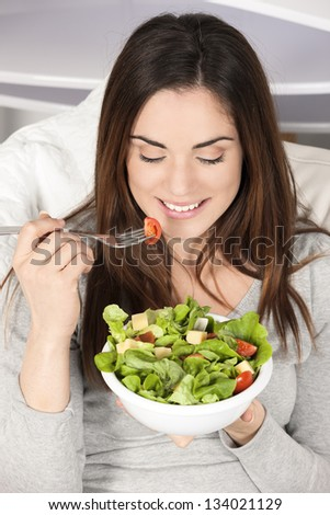 Young girl eating healthy food - stock photo