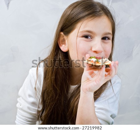 young girl eating homemade pizza - stock photo
