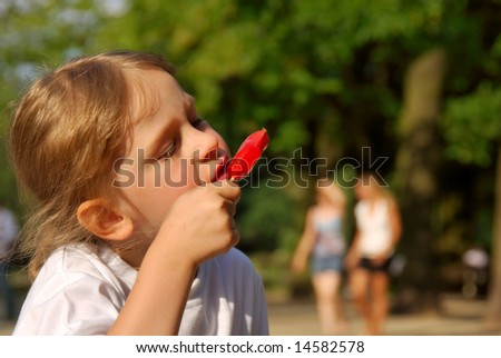 Young girl eating ice-cream - stock photo
