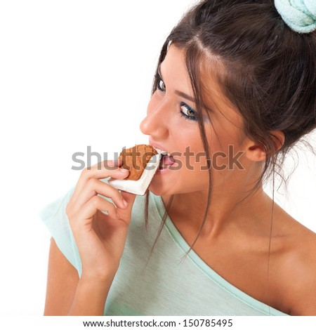 Young girl eating ice cream against white background.