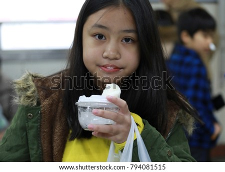 young girl eating sweet dessert