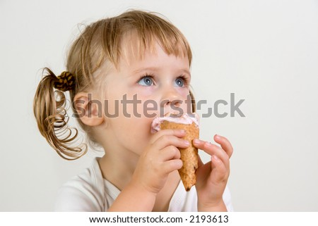 young girl eating tasty ice cream