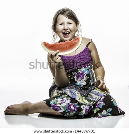 Young girl eating watermellon - stock photo