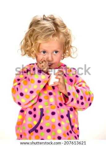 young girl eating yogurt - stock photo
