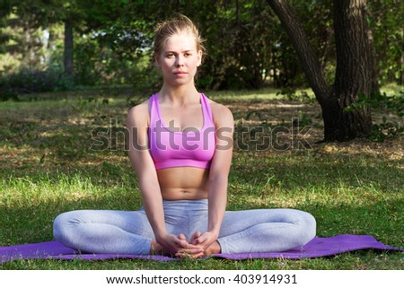 young girl engaged in yoga, gymnastics and stretching in the park