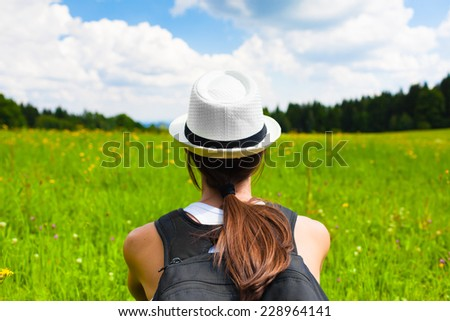 Young girl enjoying nature - stock photo