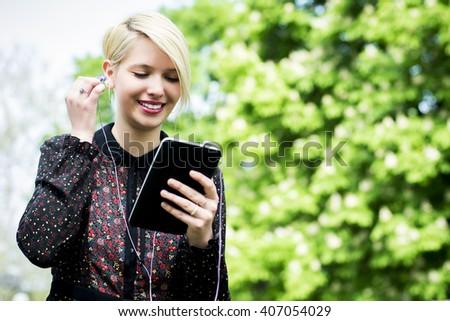 Young girl enjoying the park  - stock photo