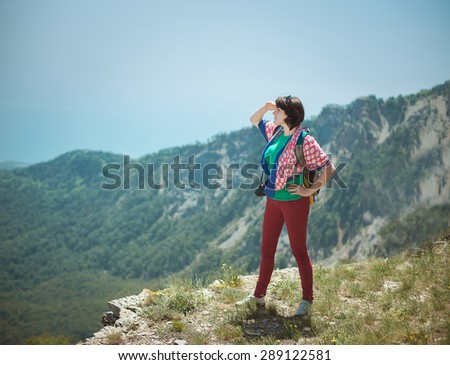 Young girl enjoying view from top of a mountain
