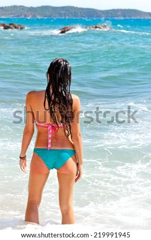 Young girl enjoys on beach - stock photo