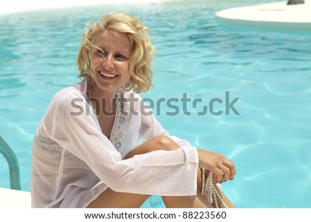Young girl enjoys the summer in the swimming pool