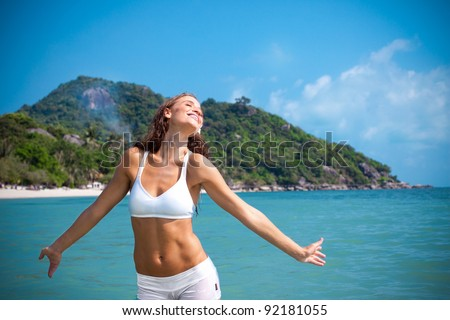 Young girl enjoys the sun, being in open water - stock photo