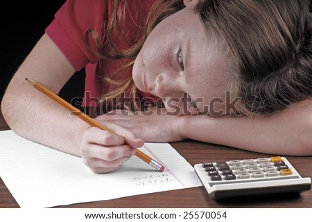 young girl erasing mistake on math homework - stock photo