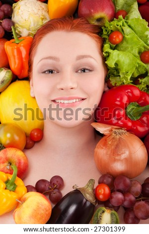 Young girl face framed with fruits and vegetables