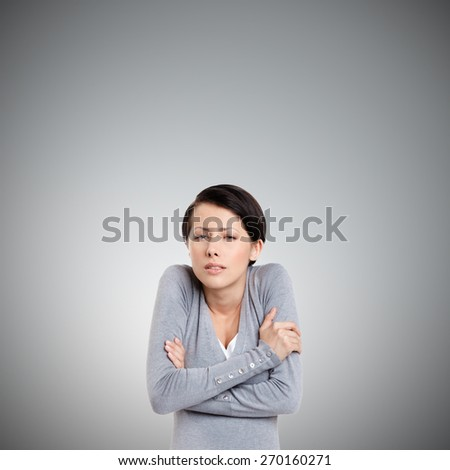 Young girl feels cold, isolated on white - stock photo