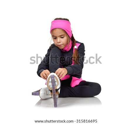 young girl figure skating skates laces - stock photo