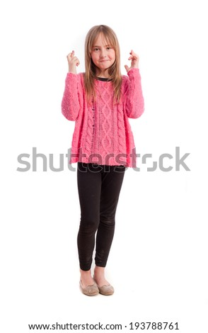 Young girl finger crossed gesture - stock photo