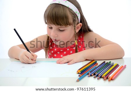 Young girl focused on new draw - stock photo