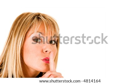 young girl gestures for silence, shhhh - stock photo