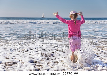 Young girl gets wetter than she planned as a wave soaks her