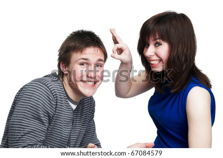 young girl gives fillip to smiley playful man isolated - stock photo
