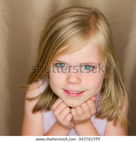 Young girl giving a sweet adorable smile - stock photo