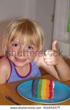 young girl giving thumbs up with rainbow cake gay marriage equality concept