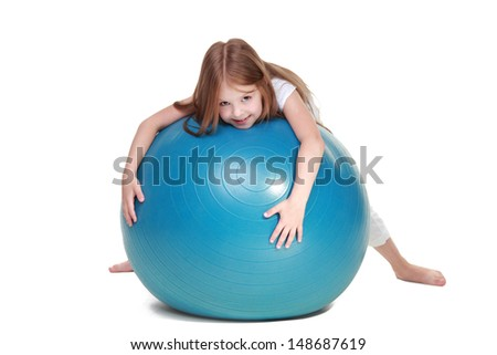 Young girl goes in for sports on fitball and smiling isolated on white