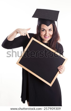 Young girl graduation with blackboard - stock photo