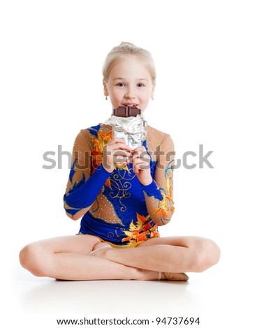 young girl  gymnast  with chocolate over white background - stock photo