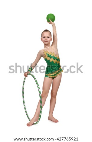 young girl gymnast with hula hoop and green ball - stock photo