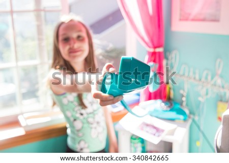 Young girl handing the phone  - stock photo