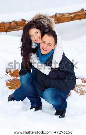 Young girl happy outside playing in the snow - stock photo