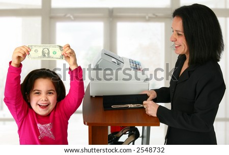 Young girl happy to have spending money. - stock photo