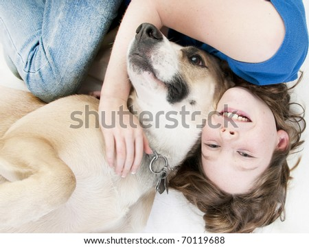 Young girl happy to lay with dog - stock photo