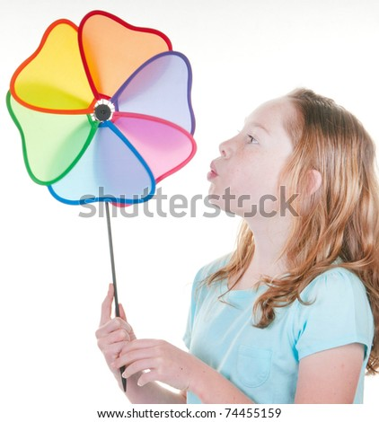 Young girl happy with wind toy - stock photo