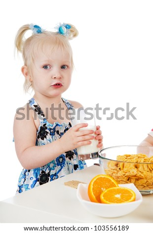 Young girl has breakfast. isolated on white background - stock photo