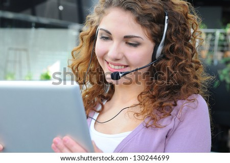 young girl having a video conference - stock photo
