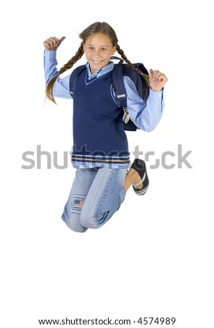 Young girl having fun. Jumping in the air with backpack. Looking at camera. Thumbs up. Isolated on white in studio
