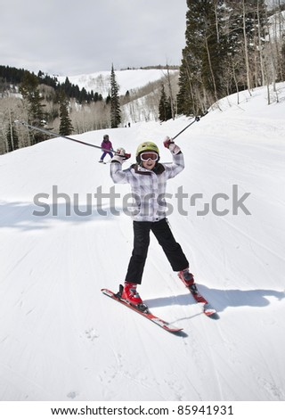 Young Girl Having Fun on the Ski Slopes - stock photo