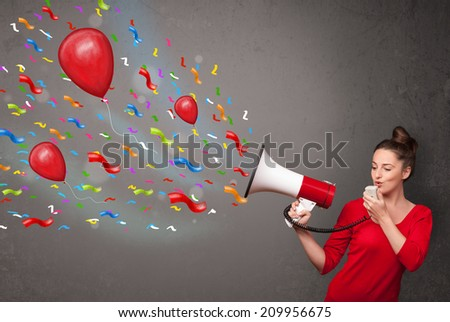 Young girl having fun, shouting into megaphone with balloons and confetti - stock photo